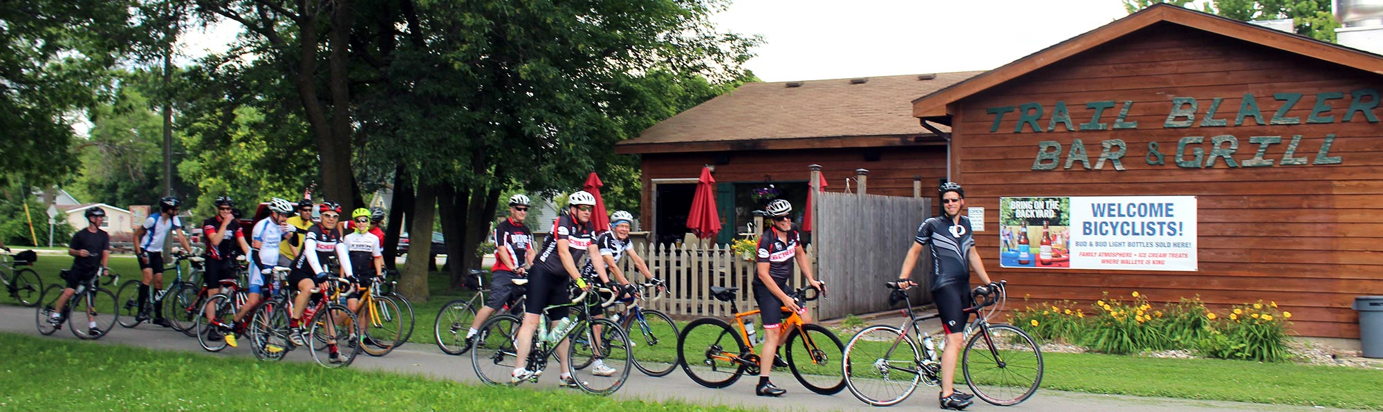 Group of bicyclists on the Sakatah Trail near Trailblazer Bar & Grill